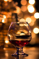 Cognac glass on the background of festive lights