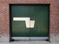 Green Industrial Door in Old Brick Building