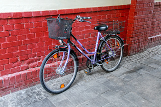 Bicycle parked by the brick wall in Wiesbaden, Hesse, Germany