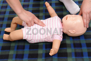 Infant dummy first aid demonstration series - first aid instructor demonstrating how to check infant life functions
