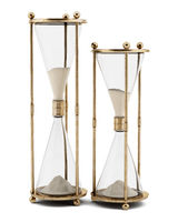 two vintage hourglasses isolated on white background