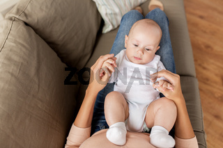 mother with little baby boy at home