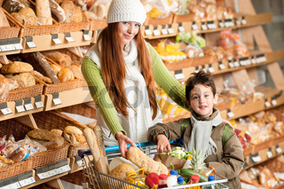 Grocery store shopping - Long red hair woman with little boy
