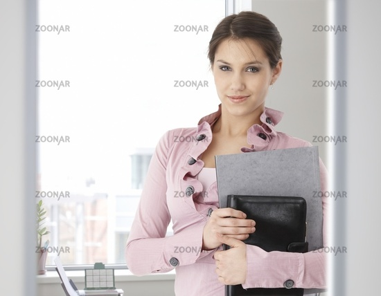 Portrait of young caucasian woman in office