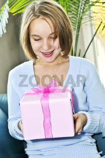 Teenage girl with present