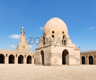 Courtyard of Ibn Tulun Mosque, Cairo, Egypt. View showing the ablution fountain and the minaret
