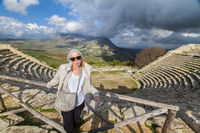 Tourist taking photo in front of greek theater of Segesta, Sicily, Italy