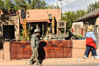 Tourists walking along colorful Canyon Road in suburb of Santa Fe, NM