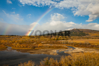 Rainbow on an autumn day near Saint Mary, Glacier National Park,