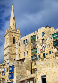 Residential houses and the steeple of St. Paul's Anglican Cathedral of Valletta, Malta