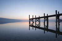 Wooden bridge reflected in Lake Constance