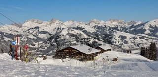 Summit restaurant on top of mount Hohe Wispile, Gstaad. Ski slopes.