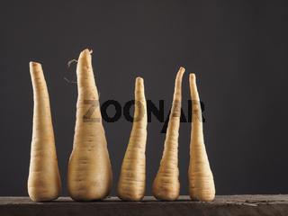 Raw parsnip in row
