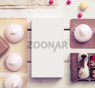 White box mockup between sweets on the table