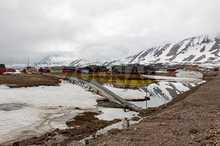 Mountains and wooden houses in Ny Alesund, Svalbard islands