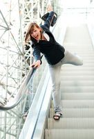 spirited woman on escalator