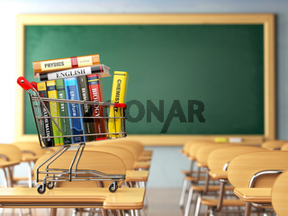 Shopping cart with book in the classroom, school desk and chalkboard. Textbooks. Back to school.