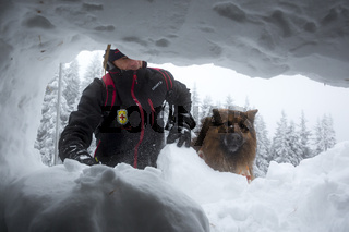 Red Cross rescuer through snow hole