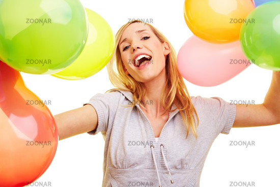 Smiling blonde with lots of balloons