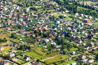 above view of many cottages in suburb village
