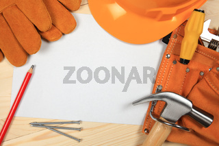 Construction helmet and tools. background
