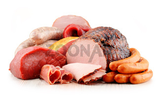 Assorted meat products including ham and sausages isolated on white background