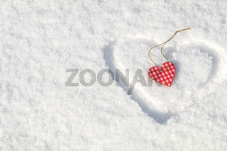 Beautiful valentine holiday background with checkered motley heart on white snow surface.