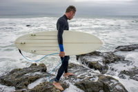 Surfer approaching the water