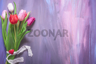 Bouquet of tulips on purple background