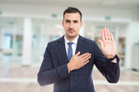 Honest trustworthy real estate agent making oath swear vow gesture