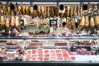chorizo and jamon serrano stalls la boqueria market barcelona spain