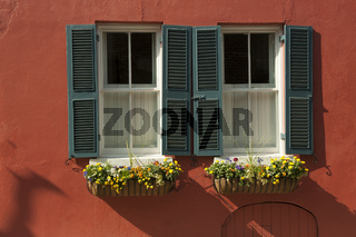 Windows with window boxes full of colorful flowers in Charleston, SC
