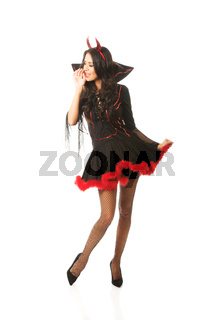 Full length woman wearing devil clothes whispering to someone