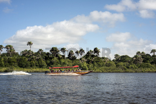 Tourists have a trip on the river Rio Preguica, Maranhao, northern Brazil into the rain forests