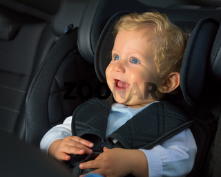 kid boy happy in a car seat