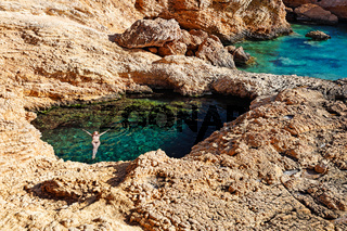 Young woman swim in Pissina of Koufonissi, Greece