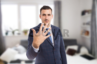 Real estate agent showing number five or fifth