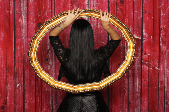 mysterious woman stands with her back in a picture frame