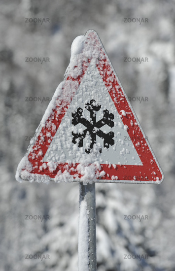 Warning sign for slippery snow in winter