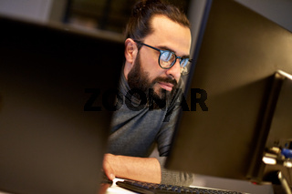 close up of creative man working at night office