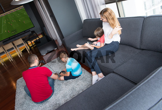 Happy family playing a football video game