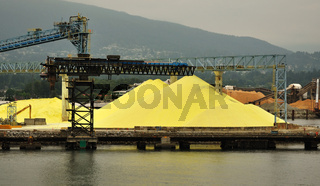 Piles of Yellow Sulphur on Dock of Chemical Processing Factory in Vancouver