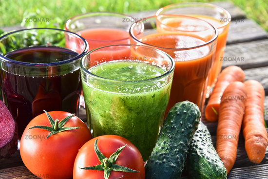 Glasses with fresh organic detox juices in the garden.