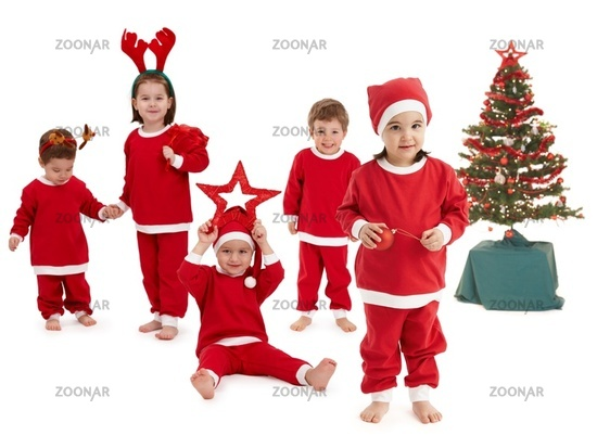 Happy little children in Santa costume