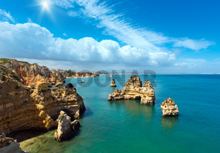 Sunshine above rocks along coast (Algarve, Portugal).