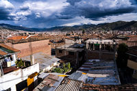 Overview of Cusco from rooftop terrace with amazing clouds