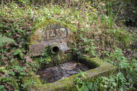 historic water well in the woods around Mainhardt, Germany