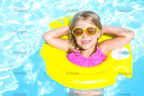 Happy child in swimming pool. Summer vacation