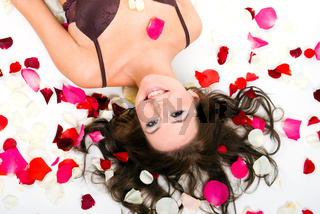 girl underwear  on  floor among red rose petals