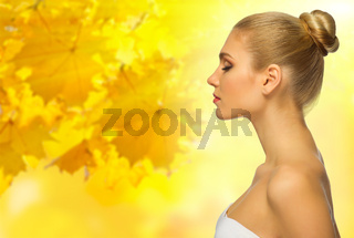 Young healthy woman at autumnal background